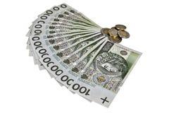 Polaco 100 billetes de banco del Zloty con las monedas Imágenes de archivo libres de regalías
