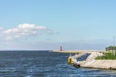 Poland Baltic Sea lighthouse. Cloudy sky Stock Image