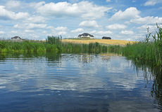 Poland.Brda river in summer.Horizontal view. Poland in summer.Pomerania.Horizontal view on the Brda river.Clouds beautifully reflected in the water and in the Stock Photo