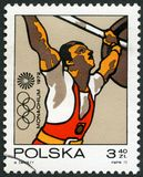 POLAND - 1971: shows Weight lifting, Olympic Rings and Motion Symbol, series 20th Olympic Games, Munich. POLAND - CIRCA 1971: A stamp printed in Poland shows Royalty Free Stock Photos