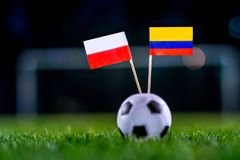 Poland - Columbia, Group H, Sunday, 24. June, Football, World Cu. P, Russia 2018, National Flags on green grass, white football ball on ground royalty free stock images