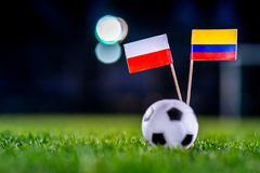 Poland - Columbia, Group H, Sunday, 24. June, Football, World Cup, Russia 2018, National Flags on green grass, white football ball. On ground stock photography