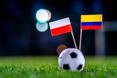 Poland - Columbia, Group H, Sunday, 24. June, Football, World Cup, Russia 2018, National Flags on green grass, white football ball. On ground stock photo