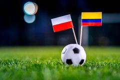 Poland - Columbia, Group H, Sunday, 24. June, Football, World Cup, Russia 2018, National Flags on green grass, white football ball. On ground royalty free stock image