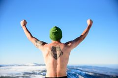 POLAND - DECEMBER 05: Wim Hof method trainee with wolf tattoo ra. Ises his arms after reaching mount Snezka summit in shorts, 2016 in Przesieka, Poland royalty free stock photos
