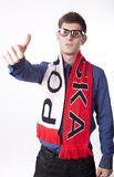 Poland fan. Man wearing Poland scarf and showing thumb up Stock Photo