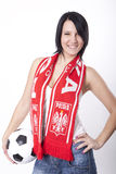 Poland fan. Girl wearing a scarf of Poland and holding football Royalty Free Stock Images