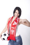 Poland fan. Girl wearing a scarf of Poland and holding football and showing victory sign Royalty Free Stock Photography