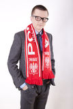 Poland fan. Young man wearing a scarf of Poland Royalty Free Stock Photography