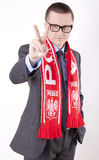 Poland fan. Young man wearing a scarf of Poland and showing victory sign Stock Photos