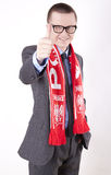Poland fan. Young man wearing a scarf of Poland and showing thumb up Stock Photography