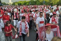 Poland fans EURO 2012. Poland fans walking through the streets of Warsaw, after the UEFA EURO 2012 Group A match against Greece on June 8, 2012 in Warsaw, Poland Royalty Free Stock Photo