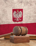 Poland flag. Wooden gavel and vintage Poland flag Royalty Free Stock Photos
