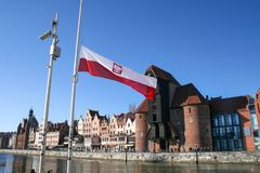 Poland flag on the background of a historic crane in Gdansk, Poland royalty free stock photography