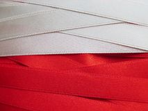 Poland flag or banner. Made with red and white ribbons Stock Images