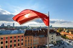 Poland Flag on centre of Warsaw Background. Poland Flag on Blue Sky and centre of Warsaw Background Stock Photos