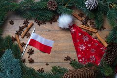 Poland flag and Christmas decoration. On wooden background Stock Images