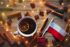 Poland flag and cup tea with Christmas ingredients. On wooden background Stock Photography