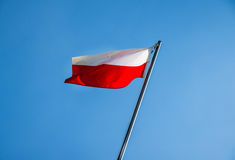 Poland flag. Fluttering on a metal flagpole Stock Image