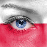 Poland flag. Human face painted with flag of Poland Royalty Free Stock Photo