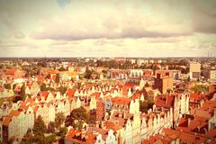Poland - Gdansk. City (also know nas Danzig) in Pomerania region. Old town aerial view. Cross processed color style - retro tone Stock Images