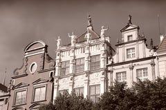 Poland - Gdansk. City (also know nas Danzig) in Pomerania region. Famous apartment buildings next to Dlugi Targ square. Sepia tone - retro monochrome color Stock Photos