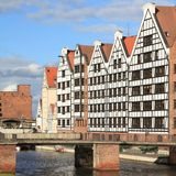Poland - Gdansk. City (also know nas Danzig) in Pomerania region. Famous old granaries next to Motlawa river Royalty Free Stock Images