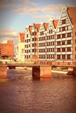 Poland - Gdansk. City (also know nas Danzig) in Pomerania region. Famous old granaries next to Motlawa river. Cross processed retro color style Stock Image