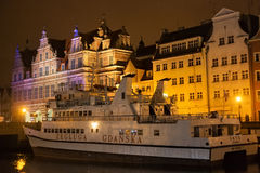 POLAND, GDANSK - DECEMBER 12, 2014: Passenger ship on the the Motlawa river in the background of the city`s historic buildings. Gdansk is a Polish city on the Stock Images