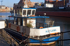 POLAND, GDANSK - DECEMBER 14, 2014: Small ship with Christmas tree on board. Stock Photos