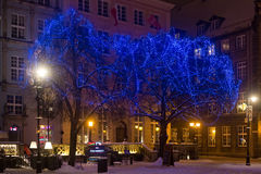 POLAND, GDANSK - DECEMBER 30, 2014: Trees in the festive decorations on Long Market Dlugi Targ street before Christmas. Gdansk is a Polish city on the Baltic Royalty Free Stock Photography