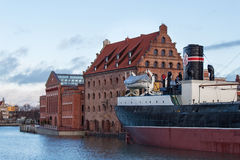 POLAND, GDANSK - DECEMBER 18, 2011: View of the ship-museum freighter Soldek near historic buildings of the island Olowianka. Royalty Free Stock Photography