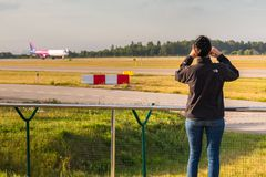 Planespotter taking photos with a cell phone Royalty Free Stock Photography