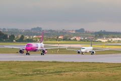 Aircraft line Wizzair taxiing on the airport runway. stock images