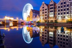 Poland. Gdansk. Quay center channel. Night view of the old houses and the Ferris Wheel in the historic center of Gdansk Stock Photos
