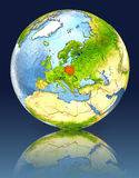 Poland on globe with reflection. Illustration with detailed planet surface. Elements of this image furnished by NASA Royalty Free Stock Photo