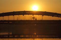 Poland, Kraków, Most Kotlarski (Kotlarski Bridge), setting sun Royalty Free Stock Images