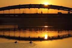Poland, Kraków, Most Kotlarski (Kotlarski Bridge), setting sun Royalty Free Stock Photos