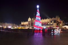 Poland, Krakow, Main Market square and Cloth Hall in winter, during Christmas fairs decorated with Christmas tree. Poland, Krakow, Main Market square and Cloth royalty free stock images