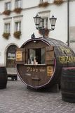 Poland, Krakow, Maly Rynek, Small Square. KRAKOW, POLAND - October 10, 2017:  A vendor selling beer and wine out of a large wooden keg in Small Square in Old Stock Image