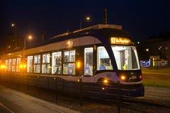 POLAND, KRAKOW - MAY 27, 2016: Night tram in the historic part of Krakow. Royalty Free Stock Photos
