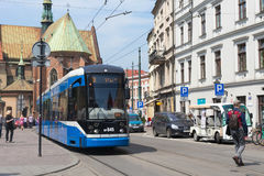 POLAND, KRAKOW - MAY 27, 2016: Tram Bombardier NGT6 in the historic part of Krakow. Stock Images