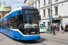POLAND, KRAKOW - MAY 27, 2016: Tram Bombardier NGT6 in the historic part of Krakow. Royalty Free Stock Photos