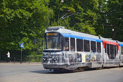 POLAND, KRAKOW - MAY 27, 2016: Tram Bombardier-Rotax/MPK EU8N in the historic part of Krakow. Royalty Free Stock Photography