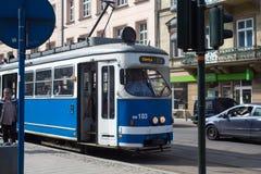 POLAND, KRAKOW - MAY 27, 2016: Tram SGP/Lohner E1 in the historic part of Krakow. Stock Photo
