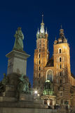 Poland, Krakow, Mickiewicz Monument, st Mary Curch Towers, Dusk Stock Images