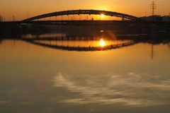 Poland, Krakow, Most Kotlarski (Kotlarski Bridge), Setting Sun, Stock Image