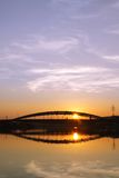 Poland, Krakow, Most Kotlarski (Kotlarski Bridge), Setting Sun, Stock Photo