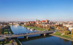Poland: Krakow panorama with Zamek Wawel Castle in autumn. Panorama of Cracow, Poland, in fall, with historic royal Zamek Wawel castle, Vistula river and Stock Image