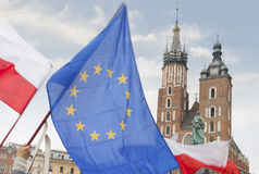 Poland, Krakow, Polish and EU Flags and Towers of St Mary Church Royalty Free Stock Photos